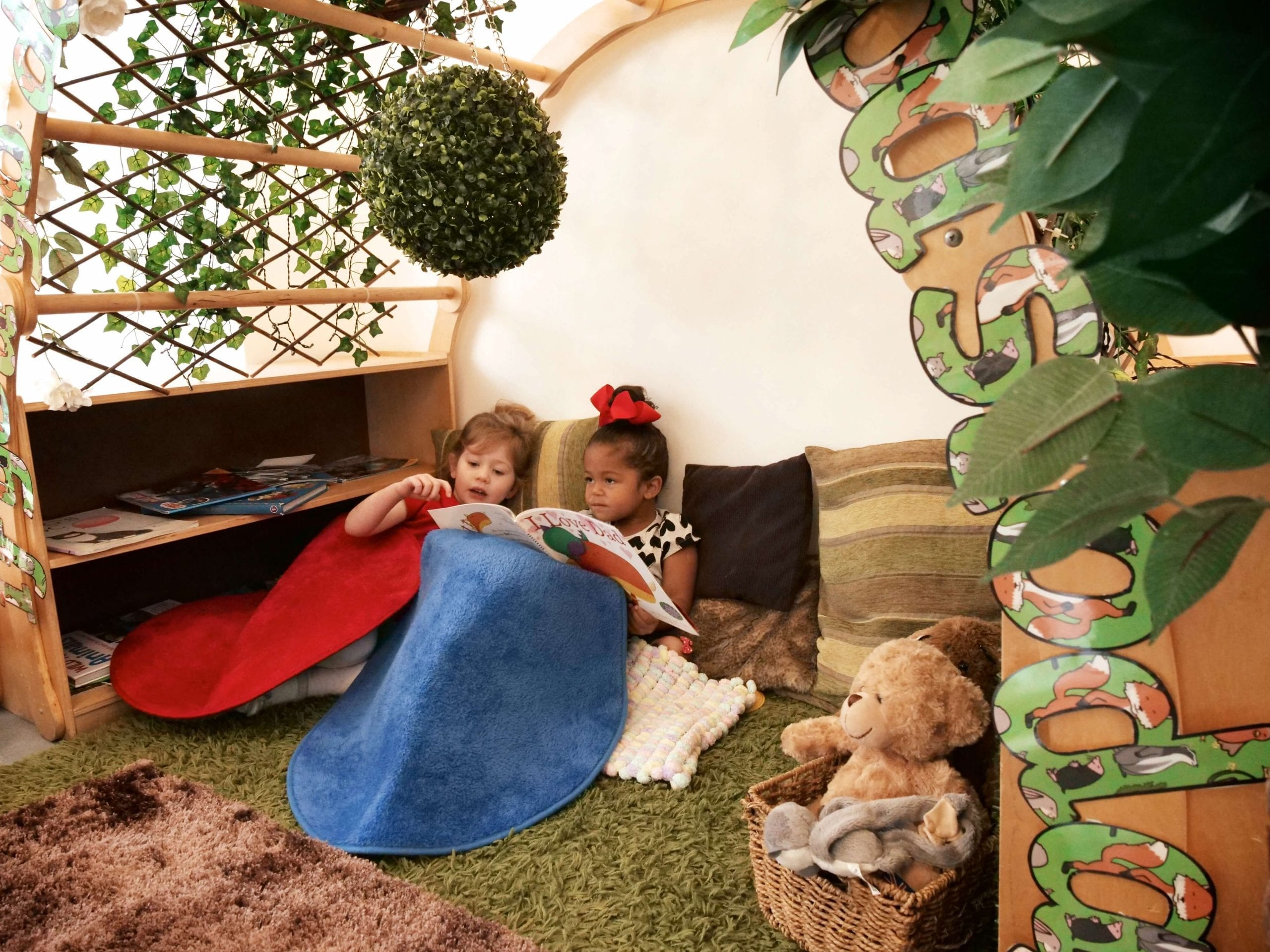two girls reading at a day nursery