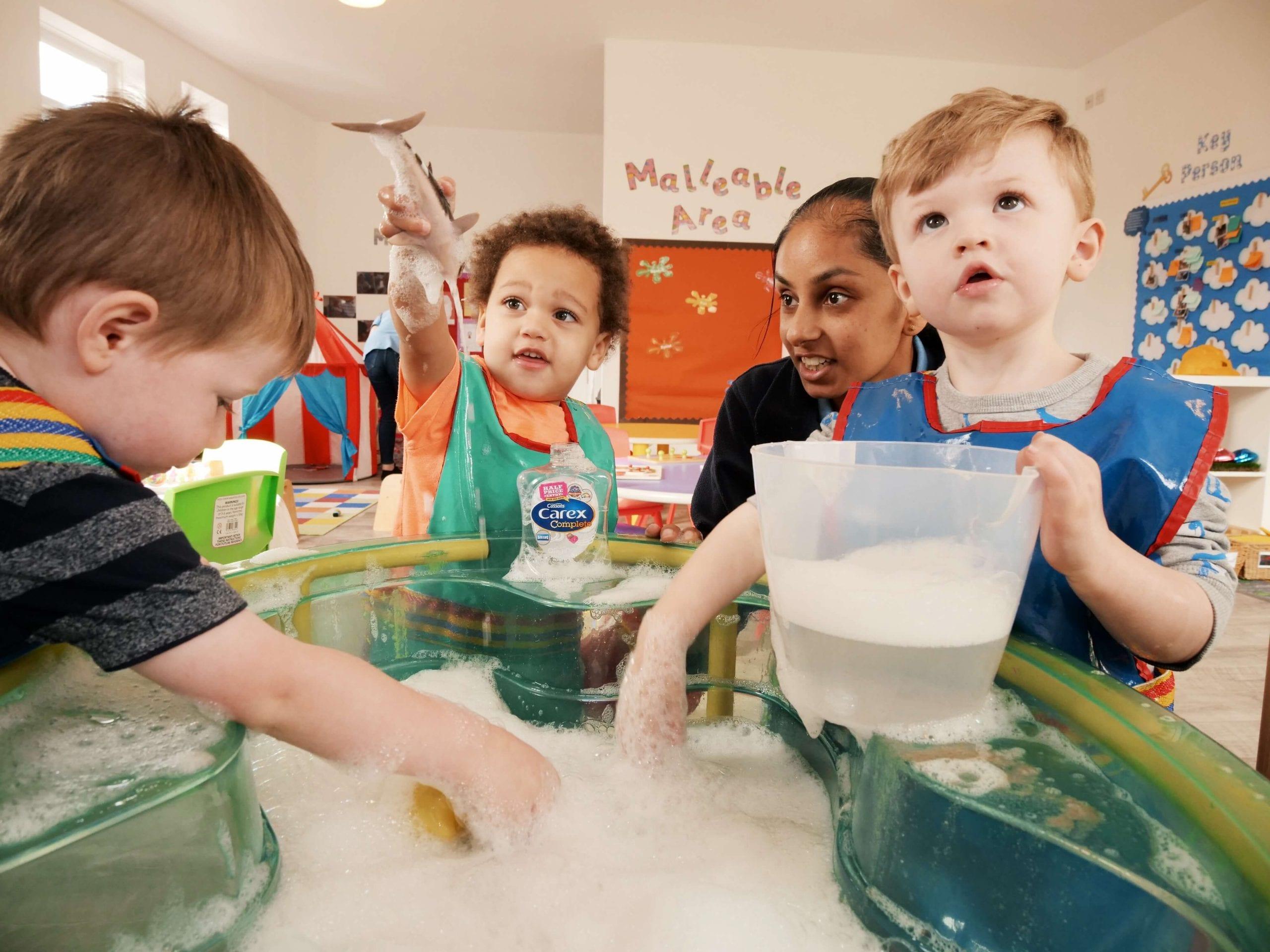 three boys enjoying baby classes at Dream Big Little one day nursery