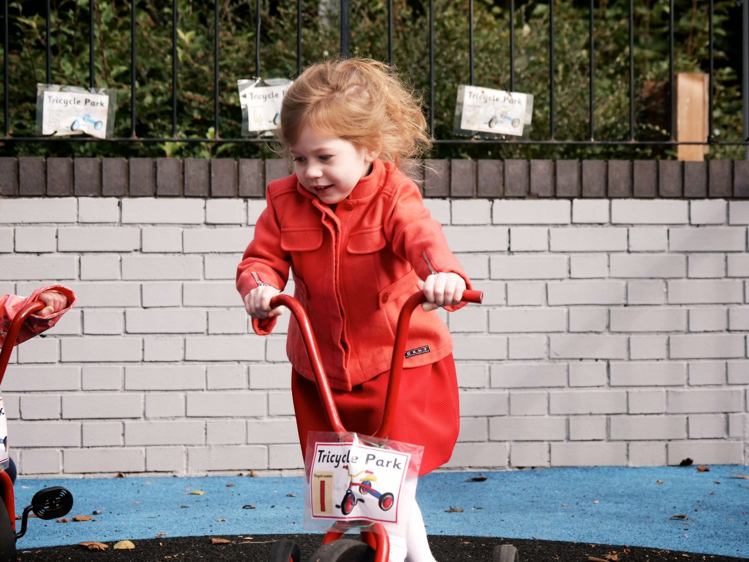 image of a child playing happily at nursery
