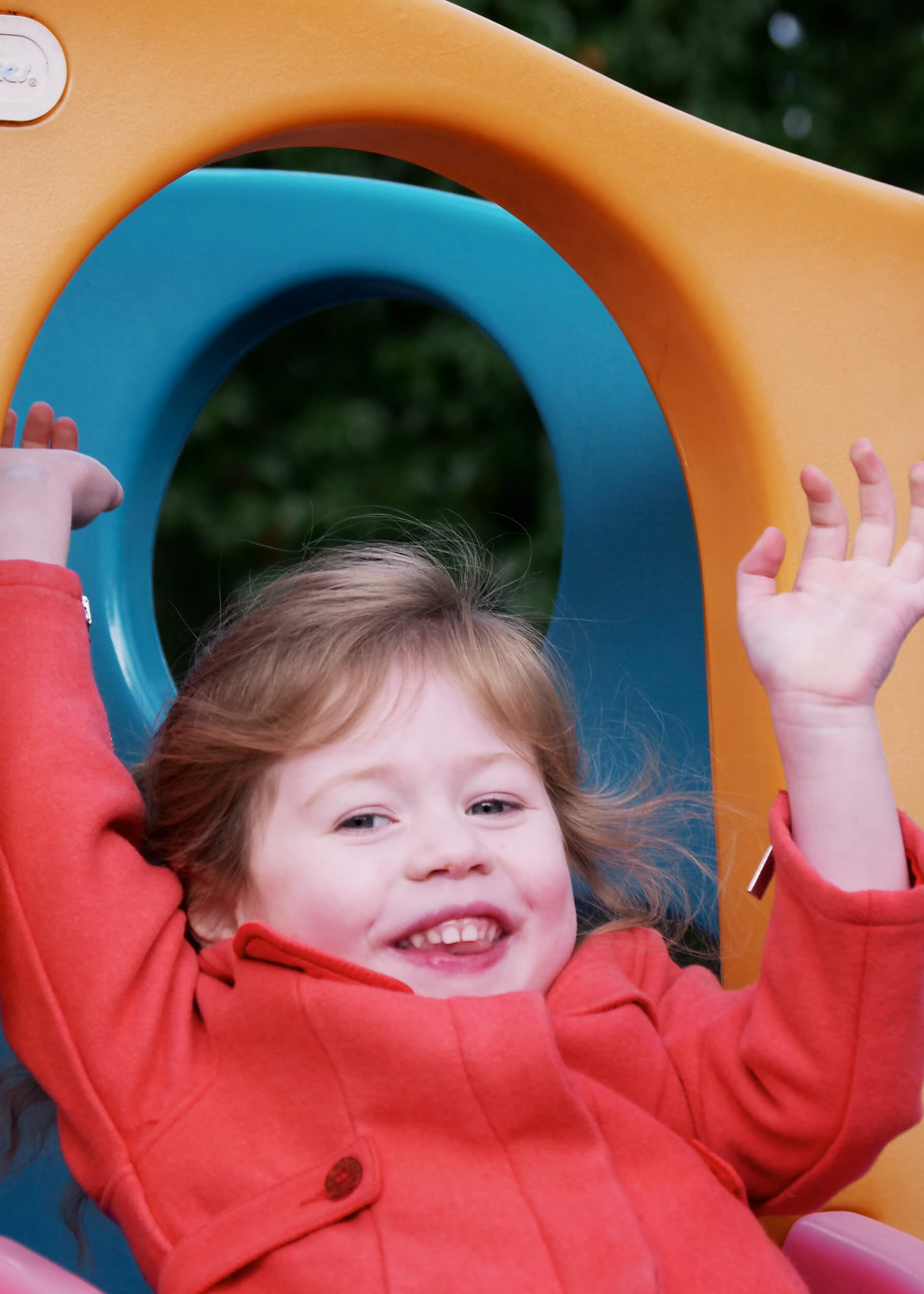 Image of a girl playing at Dream Big Little One day nursery in Bury