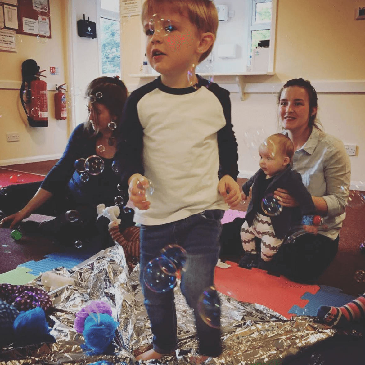Image of a boy enjoying baby classes at Dream Big Little one day nursery