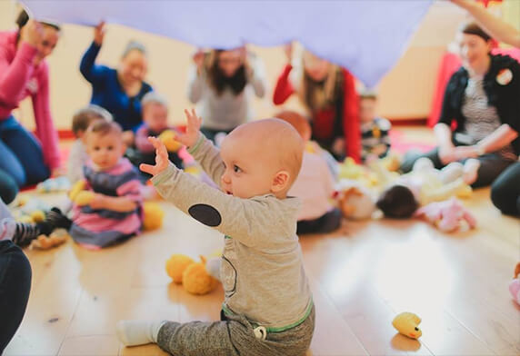 image of a baby enjoying baby classes at Dream Big Little one day nursery